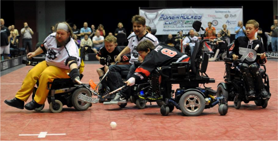 Philadelphia Powerplay forwards Liam Miller, Alex Pitts, and Jake Saxton fight for the ball against the Minnesota Saints in the Powerhockey championship game. The Powerplay went on to lose the game 5-4.