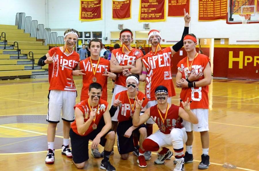 The+2014+Dodgeball+Champs%2C+The+Vipers%2C+bite+the+gold+after+their+victory+over+the+Dodge+Fathers.+The+Vipers+team+includes%3A+Drew+Fowler%2C+Luke+Marmer%2C++Jack+Halowell%2C+Alex+Ramos%2C+Matt+McKeon%2C+Chris+Trainor%2C+Dylan+Rezznick%2C+and+Corey+Hunt.