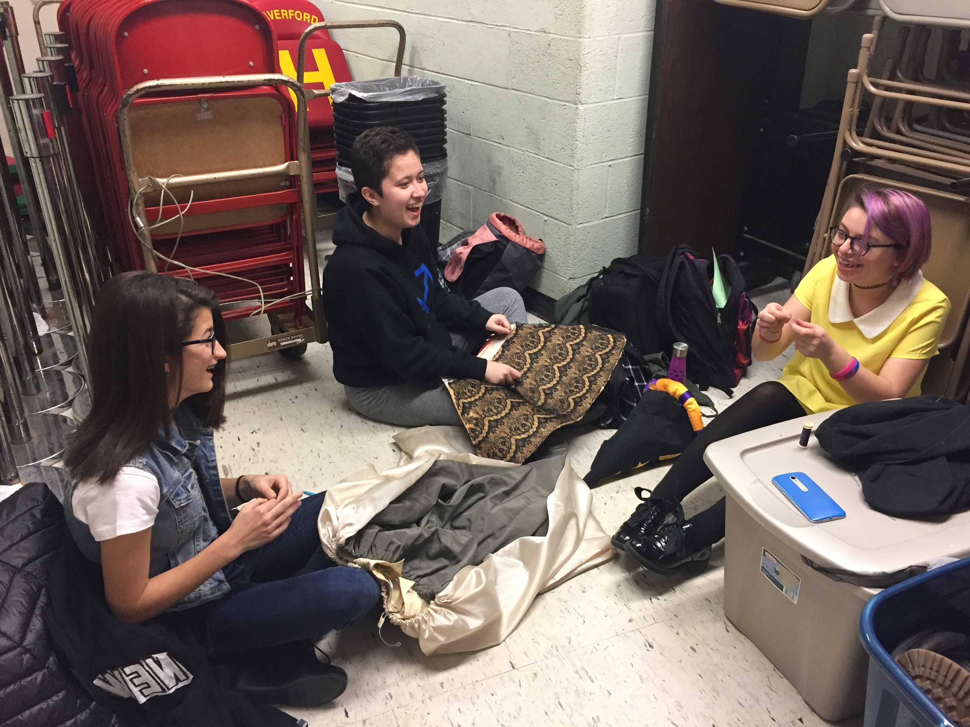 (left to right) junior Nikki Moscony, sophmore Maya Mendoza, and junior Jessica Dillon enjoy their new work space and each others company as they create costumes for the upcoming musical