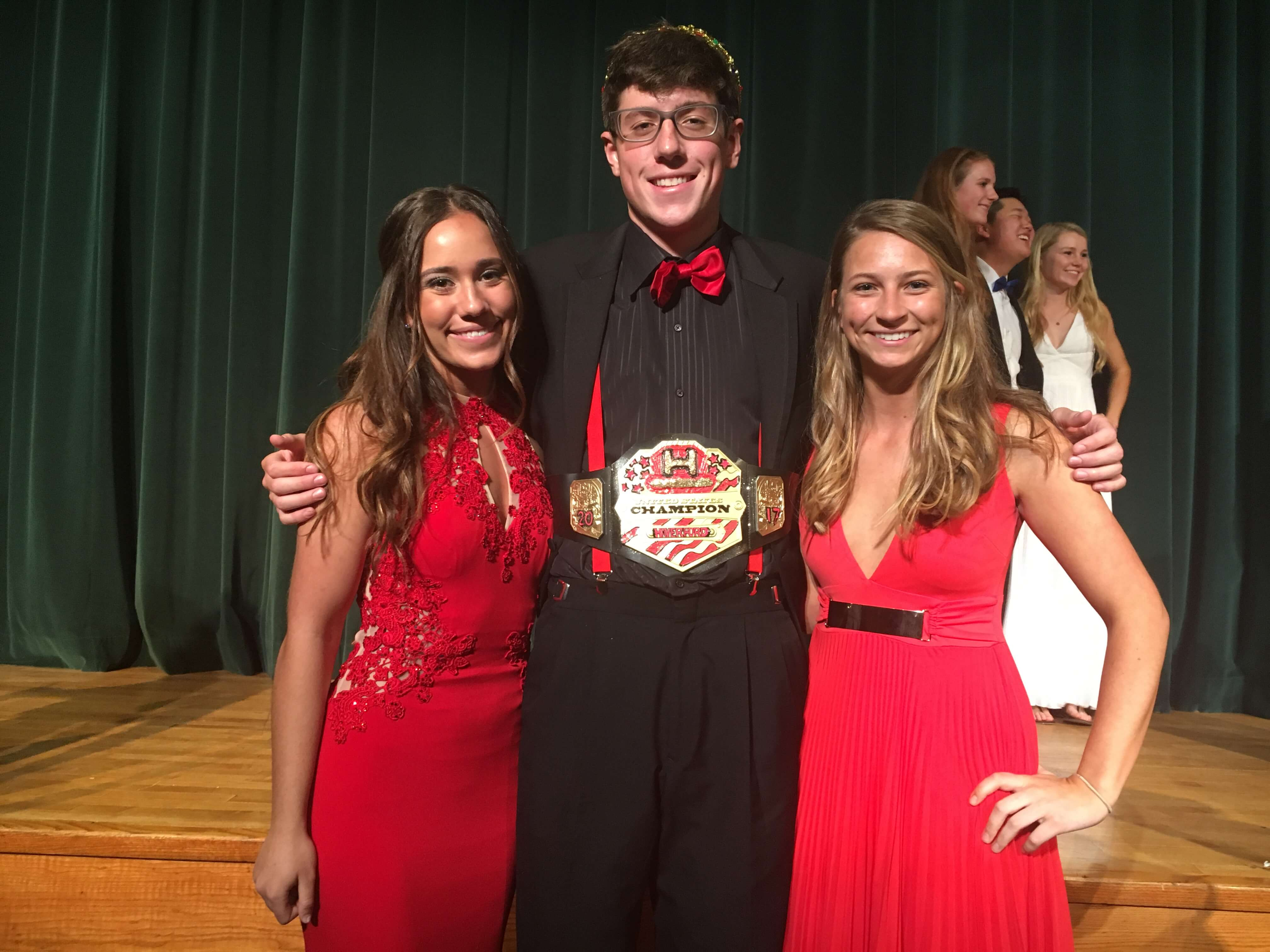 Senior escorts, Gabrielle Gentile and Amira Gallagher, flank Mr. Haverford 2017, Tyler Kimble, in the conclusion of the event.