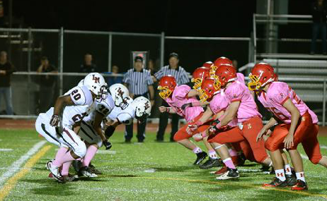 Community members sponsor football team's pink jerseys to support breast cancer awareness