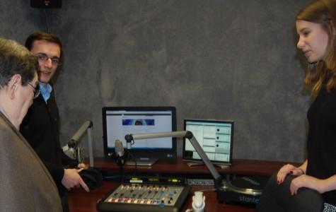 Seniors Greg Robben and Emily Yacina show Kal Rudman the new soundboard installed inside of WHHS' new studio.