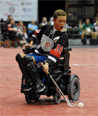 Powerplay center and two-time tournament MVP, Jake Saxton, winds up for a wrist shots during the tournament game against the Ottawa Selects in the quest for the Powerhockey Cup in St.Paul, Minnesota.