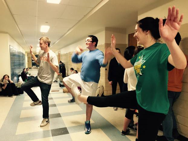 Juniors Jack Durfee and Danny Murphy practice the main dance routine during one of their breaks with fellow cast member Sophomore Gillian Watson.