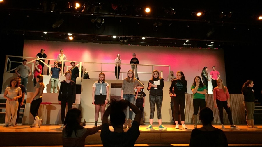 Assistant Director Ms. Montgomery (left), student leader Haley Amdur (center), and Director Heidi Uribe (right) lead the cast during rehearsal.