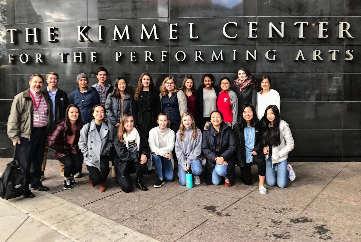 Haverford High School's String Ensemble poses in front of the Kimmel Center in Center City, Philadelphia.