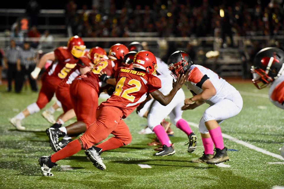 Senior defensive end CJ Weh rushes off the edge to pressure the Penncrest quarterback.