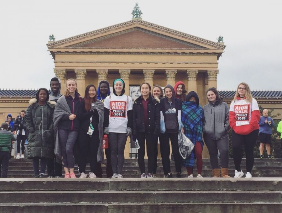Interact Club members pose on the steps of the Philadelphia Museum of Art.