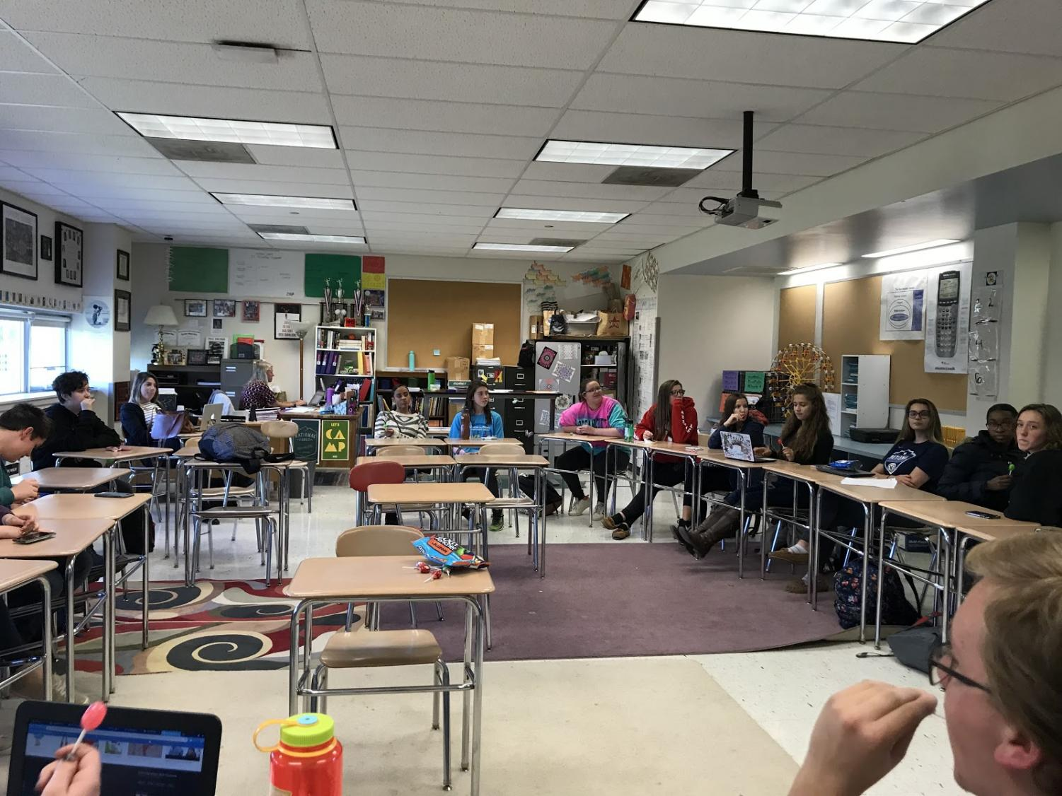 Members of Girl Up sit in a circle to discuss the topic of Sexy Halloween Costumes.
