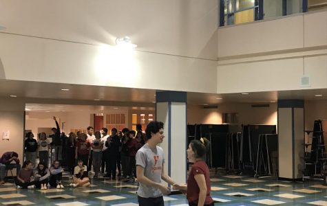 Cast of Little Shop of Horrors rehearsing in the west commons.