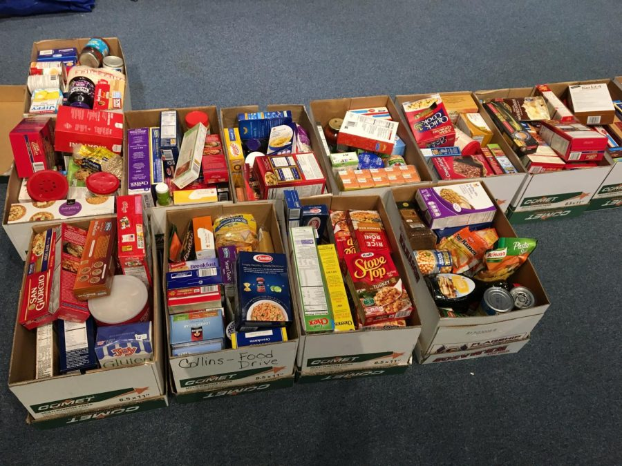 Interact+Club+members+packed+over+30+boxes+of+food+for+local+families+in+need.++