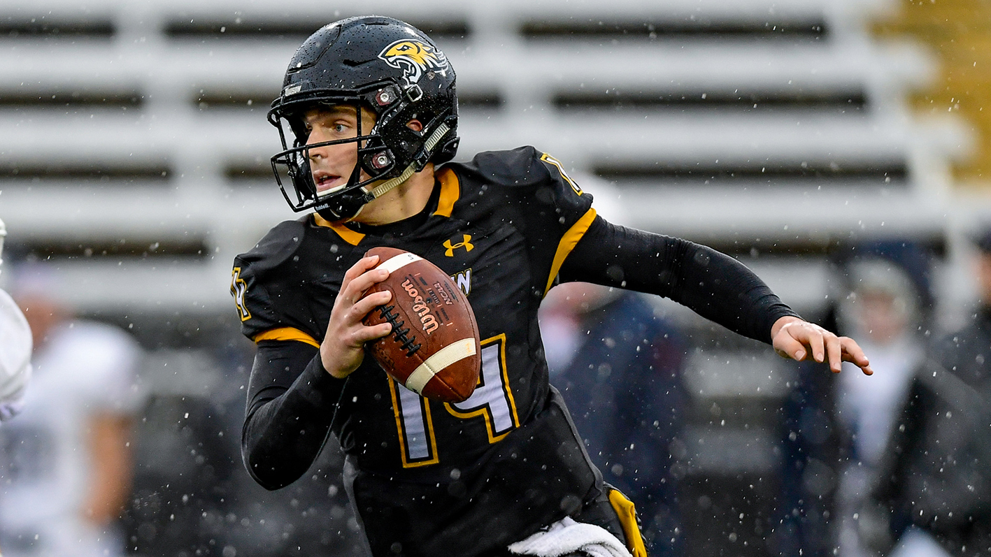 Tom Flacco is photographed playing on the football team of Towson University.