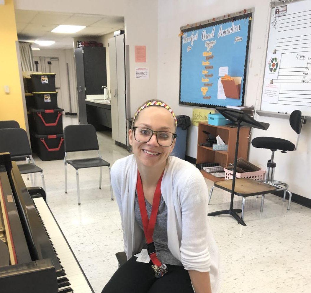 New chorus teacher Kelsey Hendler prepares for rehearsal with students.