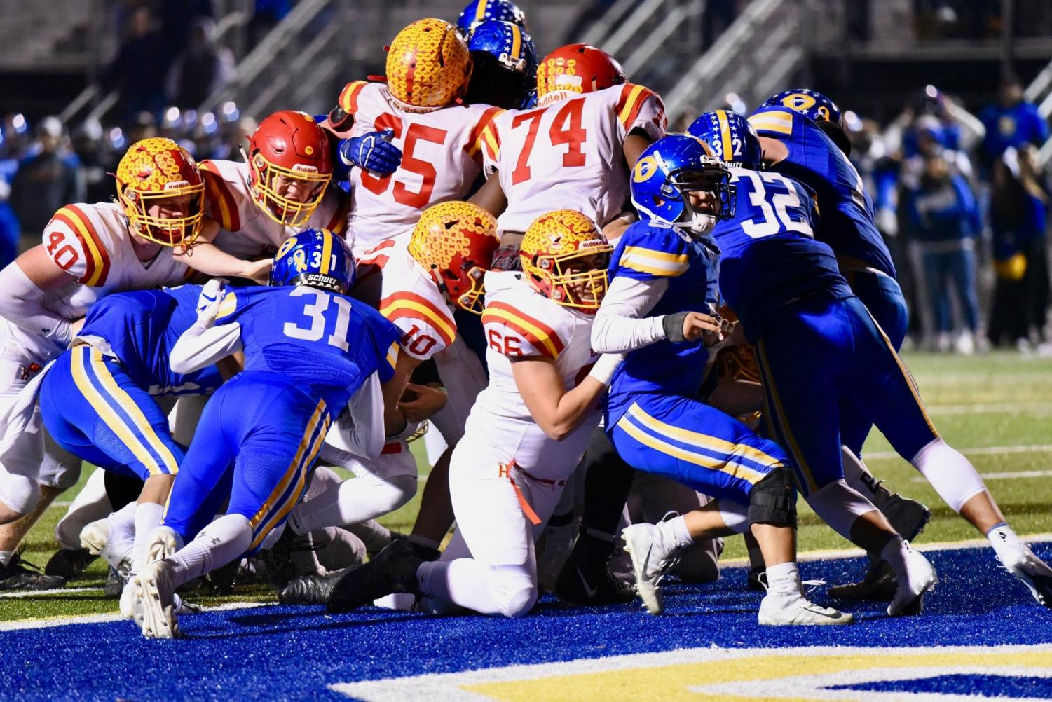 The Fords fight hard but fail to keep the Whippets out of the end zone. The final score of the exciting District Playoff game was Downingtown West 49 and Haverford 42.