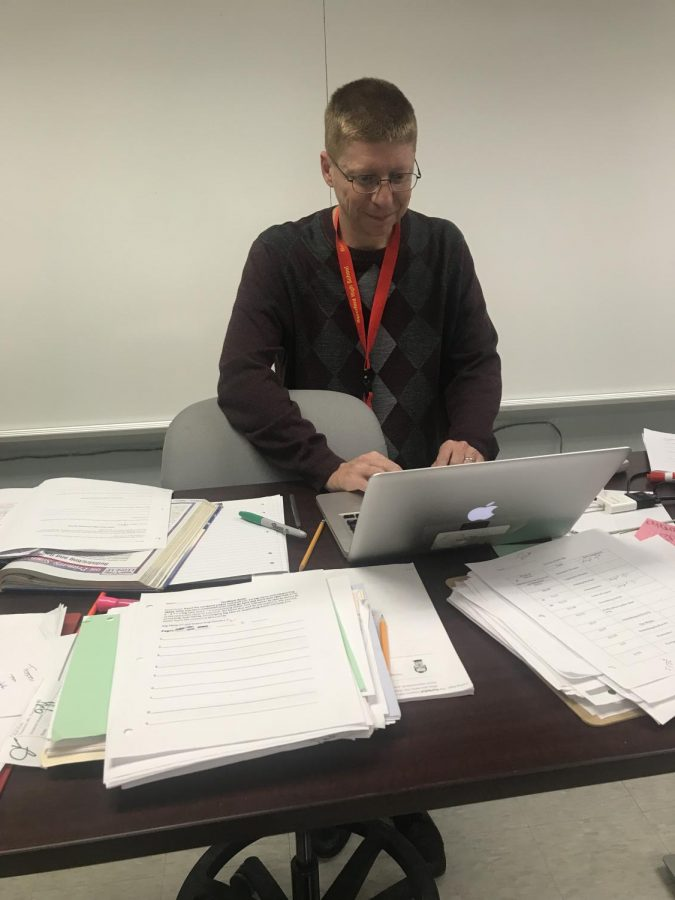 Pictured is social studies teacher Joseph Taraborrelli prepping for his next class.