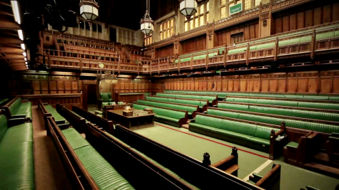 Pictured are the benches of the House of Commons in Westminster.