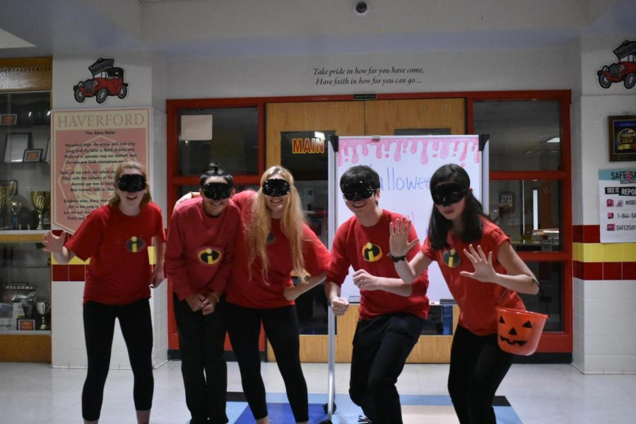Students matched their costumes as the family of The Incredibles, welcoming children into the Carnival.