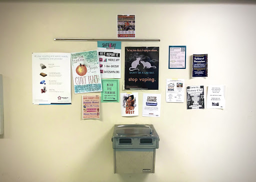 The wall outside of the first floor restrooms displays several of the numerous flyers hung by  school clubs, including No Place For Hate, Future Business Leaders of America, and History Club.