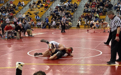 At the Southeast Regional Tournament in Souderton, Stephen Lozano competes against Roberto Lesser of Harriton.