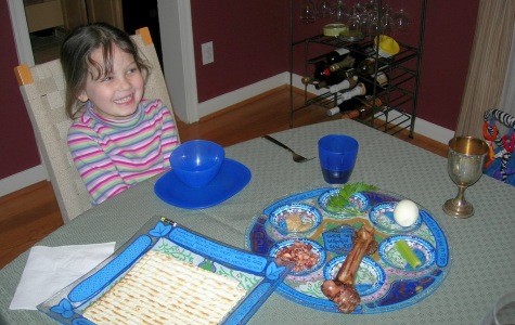A younger, gleeful Sophia Khan awaits her favorite dish, Matzah Ball Soup.