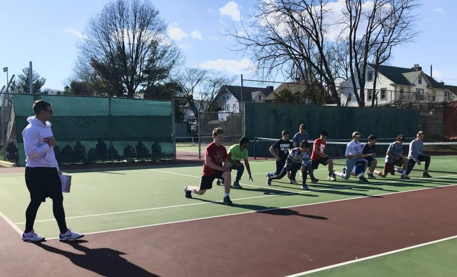 Haverford+High+School%27s+Boys%E2%80%99+Tennis+Team+warmed+up+before+an+afternoon+practice+in+the+pre-pandemic+beginning+of+the+2020+tennis+season.