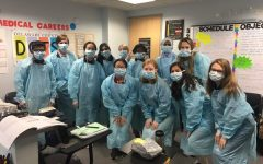Students from Haverford and Radnor High Schools learn how to properly don PPE (personal protective equipment) in clinical units at Lankenau Medical Center. Top Left to Right: Hersh Parikh, Connor Murray, Gina Ngo, Mehek Thapar, Nicole Shreiber, Marisa Torh, Rimsha Maryam, Emily Scott Bottom Left to Right: Katie Nguyen, Kylie Slupe, Leighton O'Sullivan, Nicolle Lomazoff