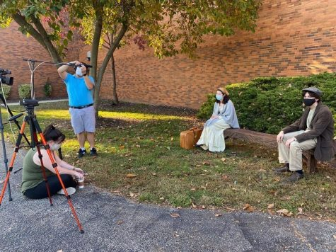 Actors Kateri Simmons (left) and Roman Fosco (right) film a scene on their set outside Haverford High School.