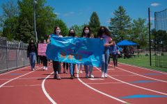 The No Place For Hate officers lead the Walk Against Asian Hate. (Left to Right: Sophomore Katie Blickley,  Senior Bella Monzo, Sophomore Jean Park, and Senior Taylor Pickering)